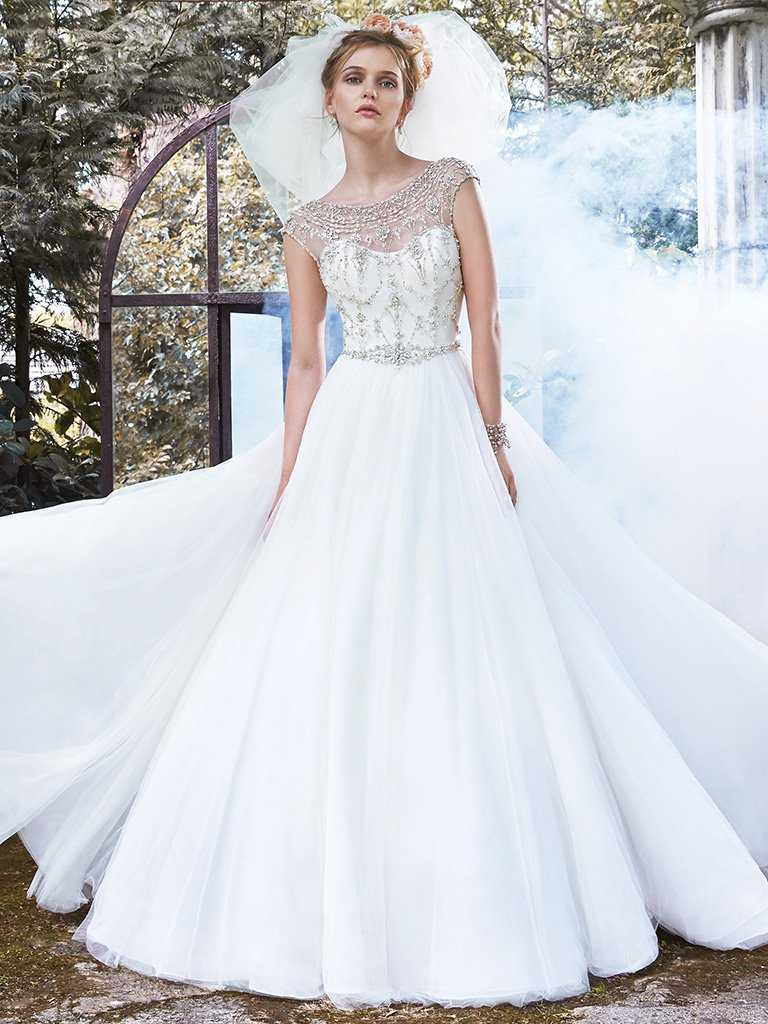 Winter wedding dresses 17 beautiful bridal gowns for your winter sparkling swarovski crystals a daring scoop back and an elegant silhouette make this one of our favourite winter wedding gowns junglespirit Gallery