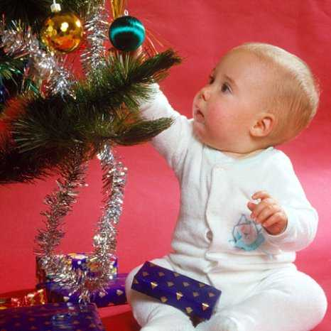 this little one is just as excited by the christmas baubles as he is his actual presents