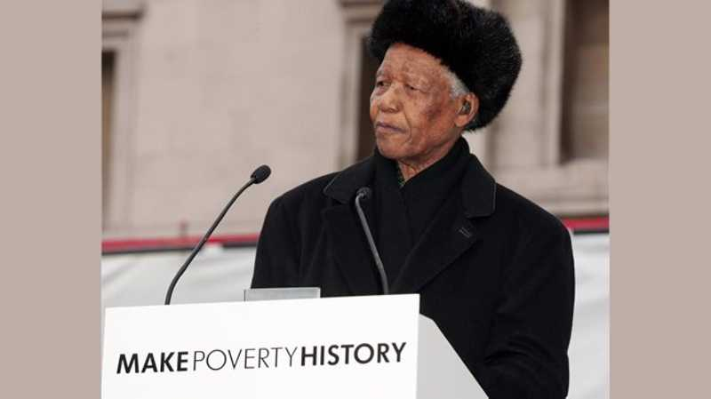 make poverty history in the speech of nelson mandela Nelson mandela waves to the crowd with bob geldof before making a speech endorsing the 'make poverty history' campaign during a mass rally in trafalgar square on february 3, 2005 in london photo.